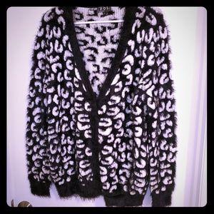 Nice Black & White Fuzzy look Sweater.